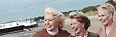 Bildmarke Gesundheit älterer Menschen - Drei ältere Frauen stehen an einem Strand