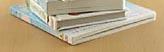 Bildmarke Neuerscheinungen - Ein kleiner Stapel mit Büchern